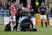 5th May 2018, Dens Park, Dundee, Scotland; Scottish Premier League football, Dundee versus Hamilton Academical; Dougie Imrie of Hamilton Academical watchesas Mark O'Hara of Dundee gets treated by physio Gerry Docherty after losing two teeth
