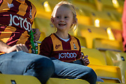 A young Bradford City fan smiling during the EFL Sky Bet League 2 match between Bradford City and Carlisle United at the Utilita Energy Stadium, Bradford, England on 21 September 2019.