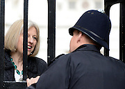 © Licensed to London News Pictures. 08/05/2012. Westminster, UK. Secretary of State for the Home Department THERESA MAY talks to a policeman through a gate.  Ministers on Downing Street today 8th May 2012. Photo credit : Stephen Simpson/LNP