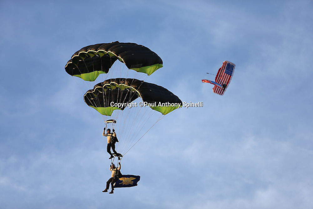 Members of the Frog-X parachute team do a tandem jump onto the field as part of Salute to the Military Week prior to the San Diego Chargers NFL week 4 preseason football game against the San Francisco 49ers on Thursday, Aug. 29, 2013 in San Diego. The 49ers won the game 41-6. ©Paul Anthony Spinelli