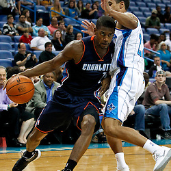 October 9, 2012; New Orleans, LA, USA; Charlotte Bobcats guard Cory Higgins (11) drives past New Orleans Hornets guard Brian Roberts (22) during the fourth quarter of a preseason game at the New Orleans Arena. The Hornets defeated the Bobcats 97-82.  Mandatory Credit: Derick E. Hingle-US PRESSWIRE