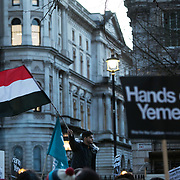 Protesters agains the visit by Saudi prince Bin Salman gather opposite Downing Street March 7th 2018 in London, United Kingdom. A young man waving the flag of Yemen. Many are angry at the Saudi involvement and continued bombing in Yemen with tens of thousands of civilian casualties and many more displaced by the war.