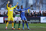 Ade Azeez of AFC Wimbledon has hassle in the box during the Sky Bet League 2 match between AFC Wimbledon and Yeovil Town at the Cherry Red Records Stadium, Kingston, England on 30 January 2016. Photo by Stuart Butcher.