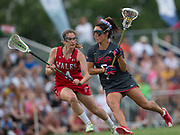 USA's Kelly Rabil  challenges with Wales' Miranda Nicholes at the 2017 FIL Rathbones Women's Lacrosse World Cup, at Surrey Sports Park, Guildford, Surrey, UK, 18th July 2017.