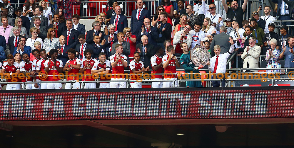 Arsenal manager Arsene Wenger hold the Community Shield with keeper Petr Cech during the FA Community Shield match between Arsenal and Chelsea at Wembley Stadium in London. 06 Aug 2017