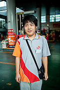 Portrait of a young man working at a petrol station in Daegu, South Korea.