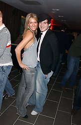 OLIVIA BUCKINGHAM and RICHARD DENNEN at the opening party for a new bowling alley All Star Lanes, at Victoria House, Bloomsbury Place, London on 19th January 2006.<br />