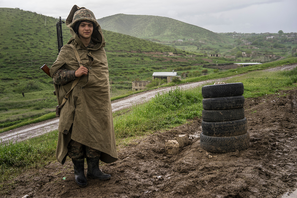 A soldier from Nagorno-Karabakh at a post near the front lines on Sunday, May 8, 2016 in Talish, Nagorno-Karabakh. Due to intense nearby fighting in early April, the entire village has been evacuated of civilians.