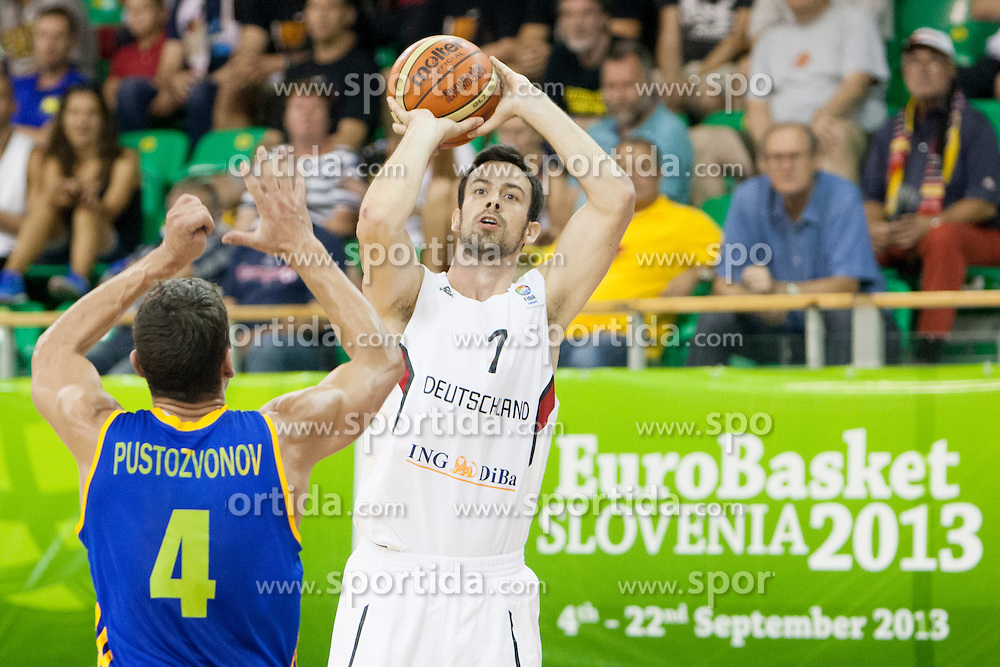 Maksym Pustozvonov #4 of Ukraine and Philip Zweiner #7 of Germany during basketball match between National teams of Germany and Ukraine at Day 3 of Eurobasket 2013 on September 6, 2013 in Tivoli Hall, Ljubljana, Slovenia. (Photo By Urban Urbanc / Sportida )