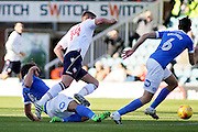 Peterborough United midfielder Michael Bostwick (4) tackles Bolton Wanderers striker Gary Madine (14) during the EFL Sky Bet League 1 match between Peterborough United and Bolton Wanderers at London Road, Peterborough, England on 13 November 2016. Photo by Nigel Cole.