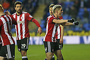 Brentford Sergi Canos (47) celebrates with the fans after the  Brentford Lasse Vibe (21) goal 1-0 second half during the EFL Sky Bet Championship match between Reading and Brentford at the Madejski Stadium, Reading, England on 20 January 2018. Photo by Gary Learmonth.