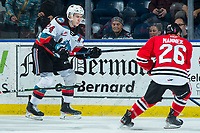 KELOWNA, BC - FEBRUARY 7: Kyle Topping #24 of the Kelowna Rockets passes the puck up the boards past Mason Mannek #26 of the Portland Winterhawks at Prospera Place on February 7, 2020 in Kelowna, Canada. (Photo by Marissa Baecker/Shoot the Breeze)