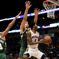 Mar 12, 2019; New Orleans, LA, USA; New Orleans Pelicans guard Elfrid Payton (4) shoots as Milwaukee Bucks center Brook Lopez (11) and forward Giannis Antetokounmpo (34) defends during the second quarter at the Smoothie King Center. Mandatory Credit: Derick E. Hingle-USA TODAY Sports