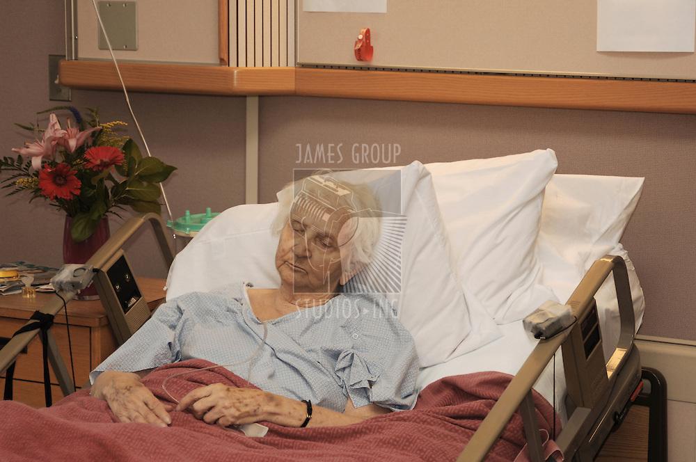 Elderly woman in hospice bed