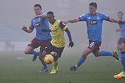 Rob Hall (19) Oxford United striker under attack from Scunthorpe United defender Murray Wallace (5) and Scunthorpe United midfielder Richard Smallwood (18)  during the EFL Sky Bet League 1 match between Scunthorpe United and Oxford United at Glanford Park, Scunthorpe, England on 26 November 2016. Photo by Ian Lyall.