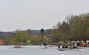Henley. United Kingdom. Osiris, left and Blondie passing Upper Thames RC. in the women's reserve boat race 2014 Henley Boat Race, Henley Reach, Annual Women's Boat Race.  River Thames; Sunday  - 30/03/2014  [Mandatory Credit;  Intersport Images],