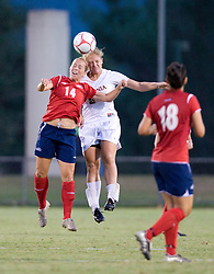 Liberty Flames midfielder/defender Mallory Neff (14) and Virginia Cavaliers defender Colleen Flanagan (24) battle for a header.  The Virginia Cavaliers defeated the Liberty Flames 5-0 in women's soccer at Klockner Stadium on the Grounds of the University of Virginia in Charlottesville, VA on August 29, 2008.