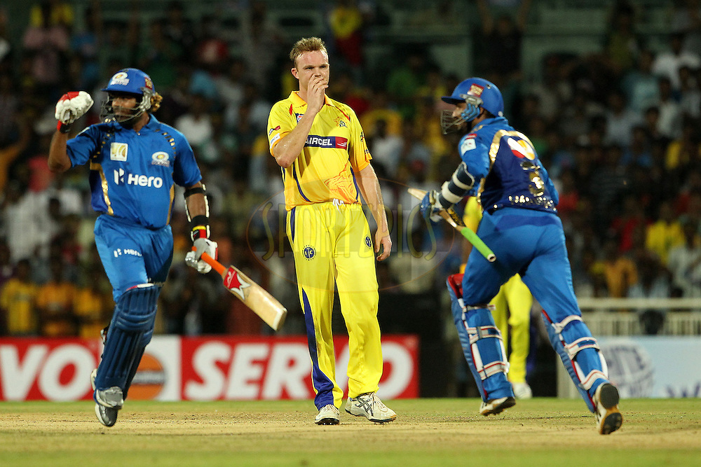 Lasith Malinga and Harbhajan Singh celebrate the win for Mumbai Indians as Doug Bollinger looks on during match 3 of the NOKIA Champions League T20 ( CLT20 )between the Chennai Superkings and the Mumbai Indians held at the M. A. Chidambaram Stadium in Chennai , Tamil Nadu, India on the 24th September 2011..Photo by Ron Gaunt/BCCI/SPORTZPICS