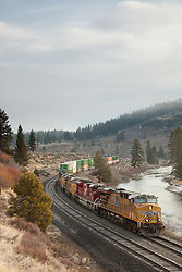"""Train along the Truckee River"" - This moving train was photographed in the early morning along the Truckee River in Truckee, CA."