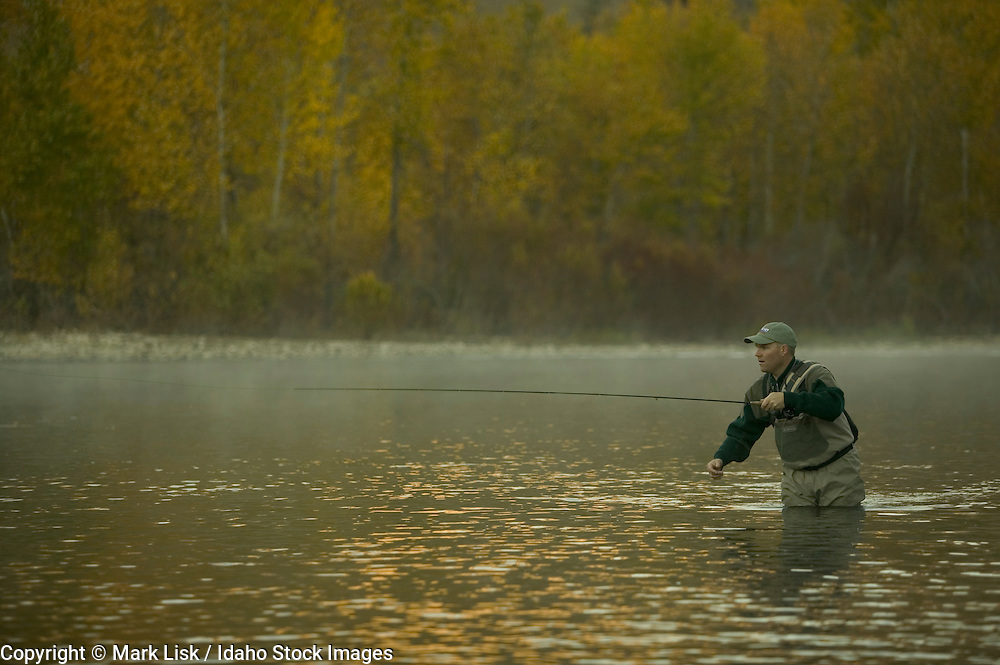 (MR) Fly fishing in the fog on the South Fork of the Boise River, Idaho.