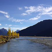 Autumn on the Dart River braided river system in Mount Aspiring National Park. near Glenorchy..Glenorchy is a small settlement nestled in spectacular scenery at the northern end of Lake Wakatipu in New Zealand's south Island. It is approximately 45 kilometres by road or boat from Queenstown, the nearest large town..Glenorchy is a popular tourist spot, close to many tramping tracks. It lies near the borders of Mount Aspiring National Park and Fiordland National Park. The local scenery received worldwide attention when it was used as one of the settings in the first of Peter Jackson's Lord of the Rings films. Glenorchy is the home of  Dart River Jet Safaris. The  unique adventure combines exhilarating wilderness jet boating with unique Funyak inflatable canoes used to explore the magnificent World Heritage wilderness within Mt Aspiring National Park. Professional guides take participants through dramatic landscapes, paddling along channels of the glacier fed Dart River's braided river system as well as along hidden side streams, rock pools and dramatic chasms. Glenorchy, New Zealand. 13th April 2011. Photo Tim Clayton..