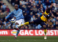 Photo: Jed Wee.<br />Manchester City v Wigan Athletic. The Barclays Premiership. 18/03/2006.<br /><br />Manchester City's David Sommeil (L) clears the ball before the challenge of Wigan's Henri Camara.