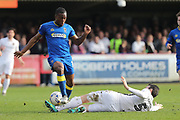 Northampton Town defender Zander Diamond (5) tackles AFC Wimbledon striker Dominic Poleon (10) during the EFL Sky Bet League 1 match between AFC Wimbledon and Northampton Town at the Cherry Red Records Stadium, Kingston, England on 11 March 2017. Photo by Stuart Butcher.
