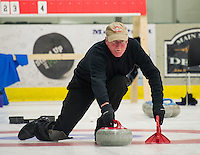 "Phil Swanson from the ""Four Sheets to the Wind"" team delivers a stone during Curling League play at the Plymouth State University Ice Rink Thursday evening.  (Karen Bobotas/for the Laconia Daily Sun)"