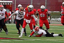 NORMAL, IL - November 17: Brady Davis gets through the middle escaping a pair of Penguin defenders to gain a first down during a college football game between the ISU (Illinois State University) Redbirds and the Youngstown State Penguins on November 17 2018 at Hancock Stadium in Normal, IL. (Photo by Alan Look)
