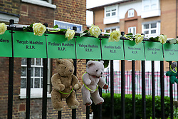 © Licensed to London News Pictures. 14/06/2019. London, UK. The names of people who lost their lives, hung from railings on a block of flats to commemorate the second anniversary of the Grenfell Tower fire service. On 14 June 2017, just before 1:00 am a fire broke out in the kitchen of the fourth floor flat at the 24-storey residential tower block in North Kensington, West London, which took the lives of 72 people. More than 70 others were injured and 223 people escaped. Photo credit: Dinendra Haria/LNP