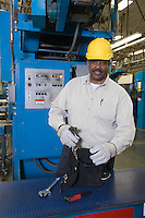 Man working in newspaper factory