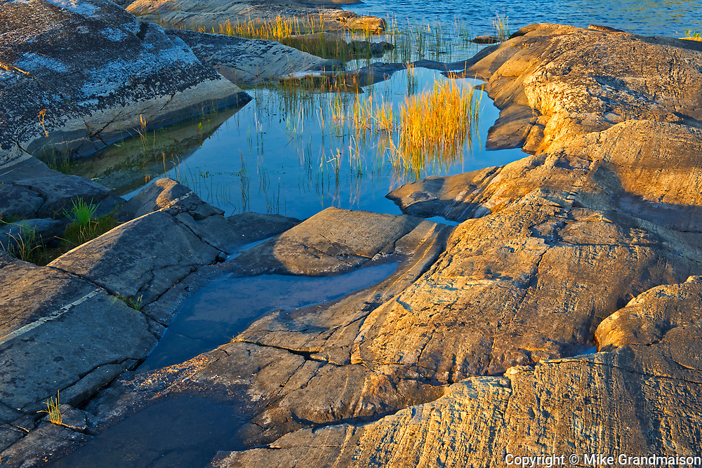 Rocky shoreline of Setting Lake at sunrise<br />