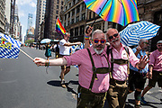 New York, NY - 30 June 2019. The New York City Heritage of Pride March filled Fifth Avenue for hours with participants from the LGBTQ community and it's supporters. Two men from Germany wearing lederhosen.