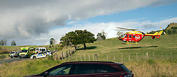 The Westpac rescue helicopter circles as armed police man a road block on Mt Tiger Road after two women were found dead and a man was taken to hospital with gunshot wounds, with the house at the centre of attention now having been engulfed in fire, Whangarei, New Zealand, Wednesday, July 26, 2017. Credit:SMPA / Malcolm Pullman   **NO ARCHIVING**