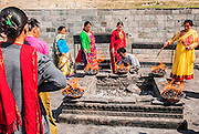 A pyre for a Hindu funeral at Pashupatinath Temple, a Hindu temple located on the banks of the Bagmati River. Kathmandu, Nepal