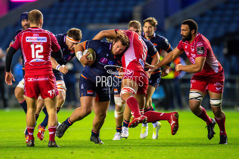 Pierre Schoeman (#1) of Edinburgh Rugby charges at Juandre Kruger (#5) of Scarlets during the Guinness Pro 14 2019_20 match between Edinburgh Rugby and Scarlets at BT Murrayfield Stadium, Edinburgh, Scotland on 26 October 2019.