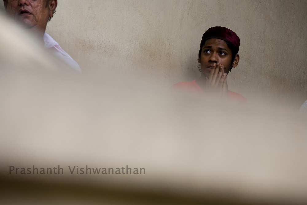 A Parsi man prays as he sits at the Kappawala Agiary, or Fire Temple, on Navroze, the Parsi new year, in Mumbai, India, Tuesday, Aug. 19, 2008. Parsis, also known as Zoroastrians, worship fire and are followers of the Bronze Age Persian prophet Zarathustra. According to estimates there are only 150,000 Zoroastrians in the world today and more than 80,000 live in India, mostly in Mumbai. Photographer:Prashanth Vishwanathan/Atlas Press