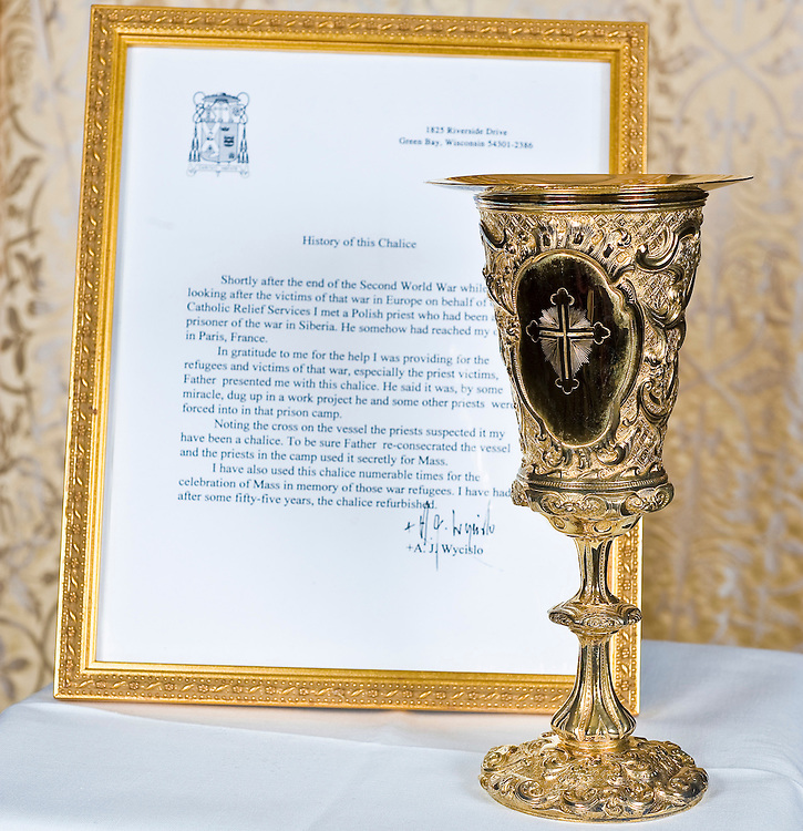 A chalice and paten belonging to Bishop Aloysius Wycislo stand near a letter written by the bishop describing the chalice's history. (Sam Lucero | The Compass)