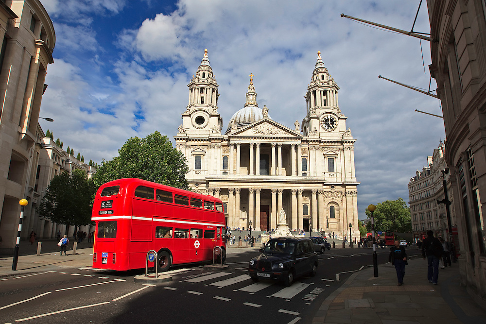 Classic red, double decker bus passes St. Paul's Cathedral in London.