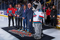 KELOWNA, CANADA - OCTOBER 3:  Former Kelowna Rockets players Kelly Guard and Josh Gorges stand on the ice with bid committee chairman Tom Dyas, Mayor Colin Basran and GM Bruce Hamilton on October 3, 2018 at Prospera Place in Kelowna, British Columbia, Canada.  (Photo by Marissa Baecker/Shoot the Breeze)  *** Local Caption ***