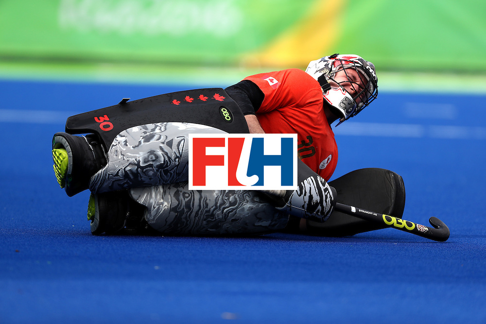 RIO DE JANEIRO, BRAZIL - AUGUST 08:  David Carter #30 of Canada rimaces after being hit by a shot on goal against Argentina during a Men's Pool B match on Day 3 of the Rio 2016 Olympic Games at the Olympic Hockey Centre on August 8, 2016 in Rio de Janeiro, Brazil.  (Photo by Sean M. Haffey/Getty Images)