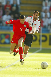 OSLO, NORWAY - Thursday, May 27, 2004:  Wales' Mark Delaney and Norway's Magne Hoset during the International Friendly match at the Ullevaal Stadium, Oslo, Norway. (Photo by David Rawcliffe/Propaganda)