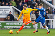 Garry Thompson (Midfielder) of Wycombe Wanderers passes the ball shadowed by Hartlepool United midfielder Nicky Featherstone during the Sky Bet League 2 match between Hartlepool United and Wycombe Wanderers at Victoria Park, Hartlepool, England on 16 January 2016. Photo by George Ledger.