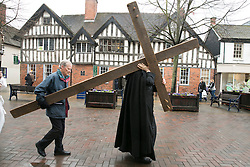 "3/4/2015. Solihull, West Midlands, UK. The Good Friday ""Walk of Witness"" taking place in Solihull. People of all faiths congrgate outside St Alphege Church and walk the short distance to Mell Square to hold a multi-faith prayer meeting. Pictured, The cross begins it's journey through Solihull going past the historic Manor House on the High Street. Photo credit : Dave Warren/LNP"