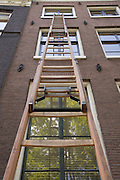 ladder against the outside of a house Amsterdam The Netherlands
