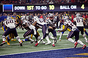 New England Patriots quarterback Tom Brady (12) hands off the ball to Patriots rookie running back Sony Michel (26) near his own end zone in the fourth quarter during the NFL Super Bowl 53 football game against the Los Angeles Rams on Sunday, Feb. 3, 2019, in Atlanta. The Patriots defeated the Rams 13-3. (©Paul Anthony Spinelli)