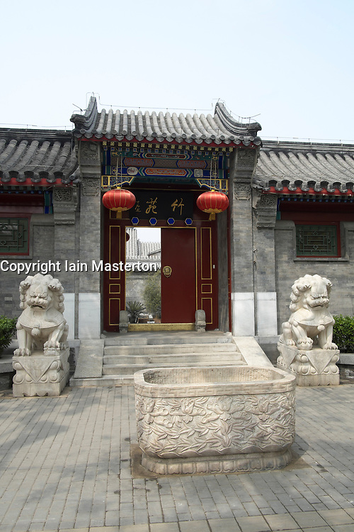 Entrance to traditional courtyard house now renovated and converted into exclusive private home in central Beijing China