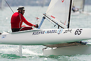 Georg Reuter (GER2) rounds the top mark in race seven of the A Class World championships regatta being sailed at Takapuna in Auckland. 15/2/2014