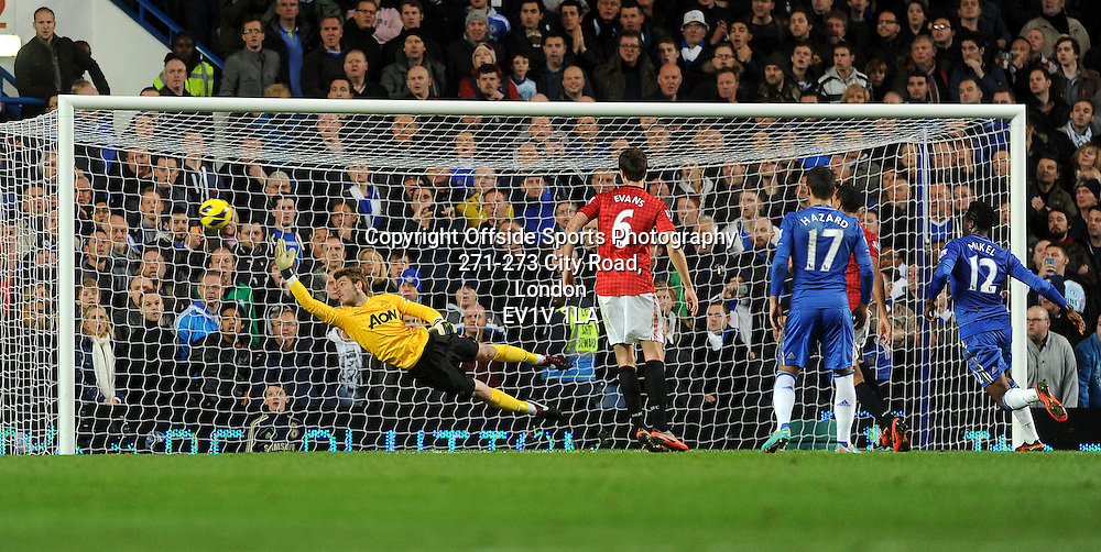 28/10/2012 - Barclays Premier League Football - 2012-2013 - Chelsea v Manchester United - United keeper David De Gea can't keep put Juan Mata's free kick. - Photo: Charlie Crowhurst / Offside.