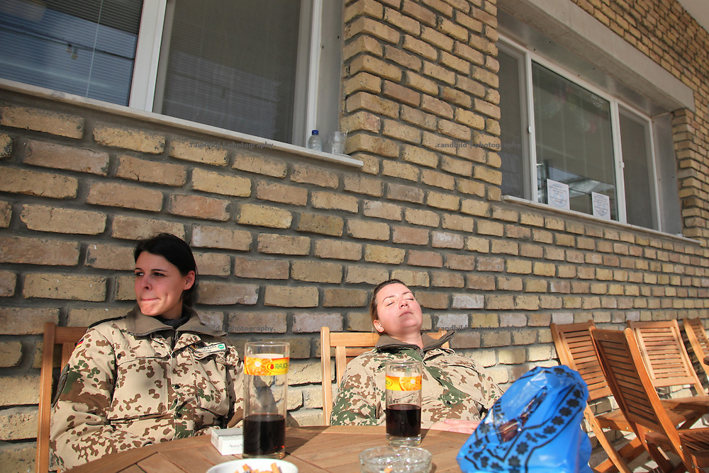 Two female german ISAF soldiers take a rest in the winter sun of northern Afghanistan in Camp Marmal in Mazar-e Sharif.